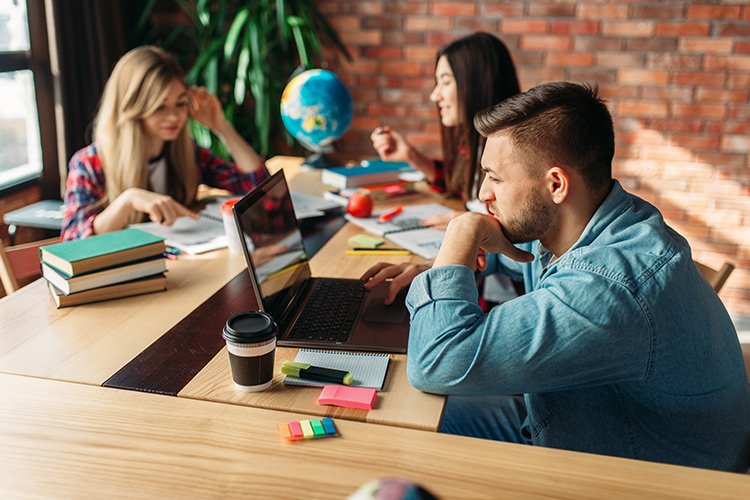 Learn at Home Cyprus - Group of students studying on laptop